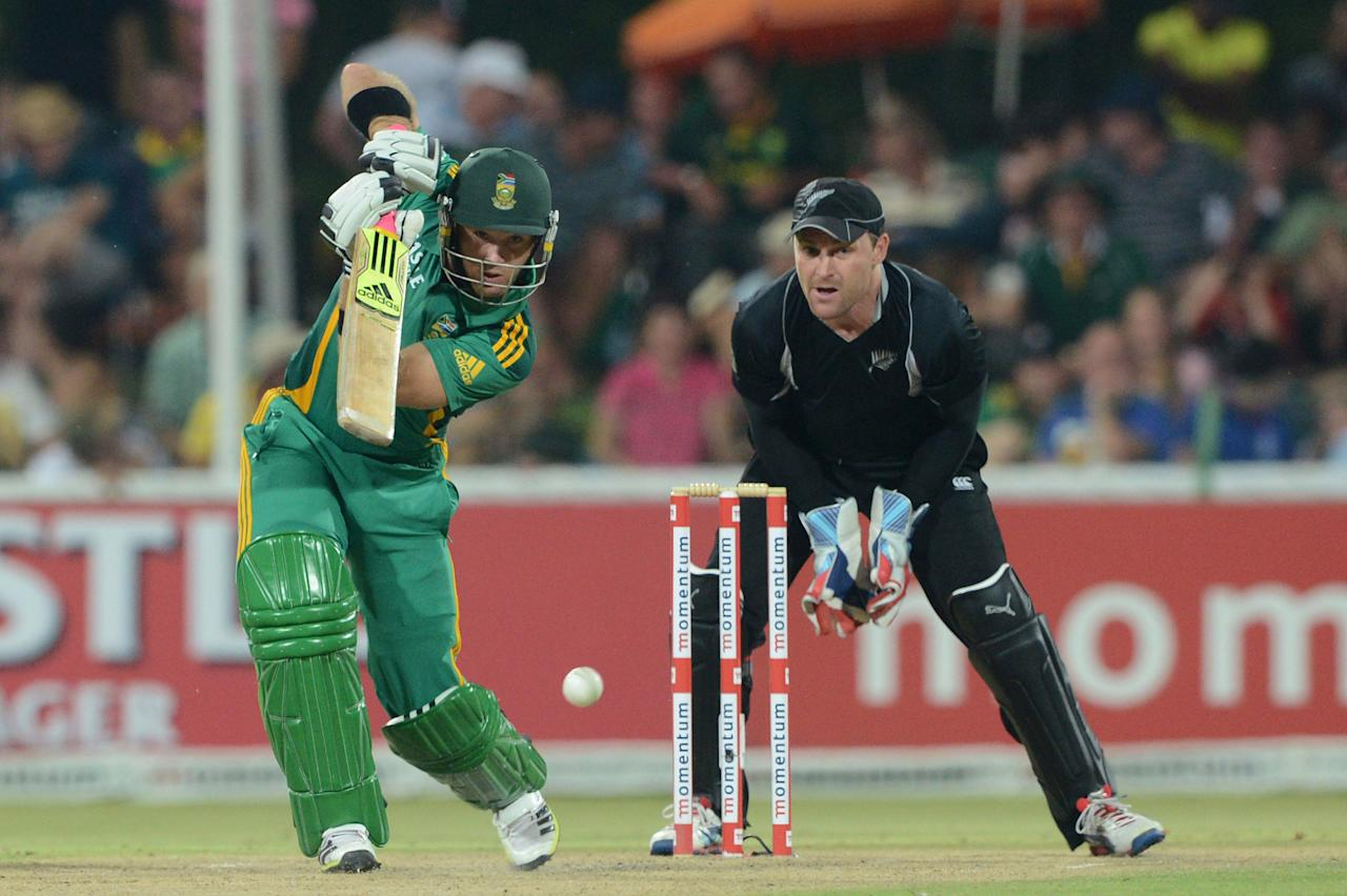 POTCHEFSTROOM, SOUTH AFRICA - JANUARY 25:  Brendon McCullum of New Zealand looks on as Colin Ingram of South Africa drives during the 3rd One Day International match between South Africa and New Zealand at Senwes Park on January 25, 2013 in Potchefstroom, South Africa.  (Photo by Lee Warren/Gallo Images/Getty Images)