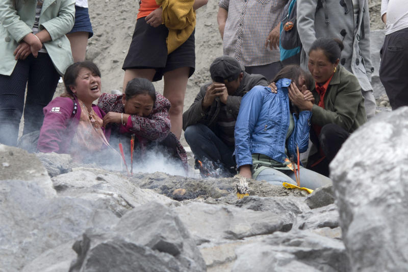 Fresh landslide at site of disaster in China