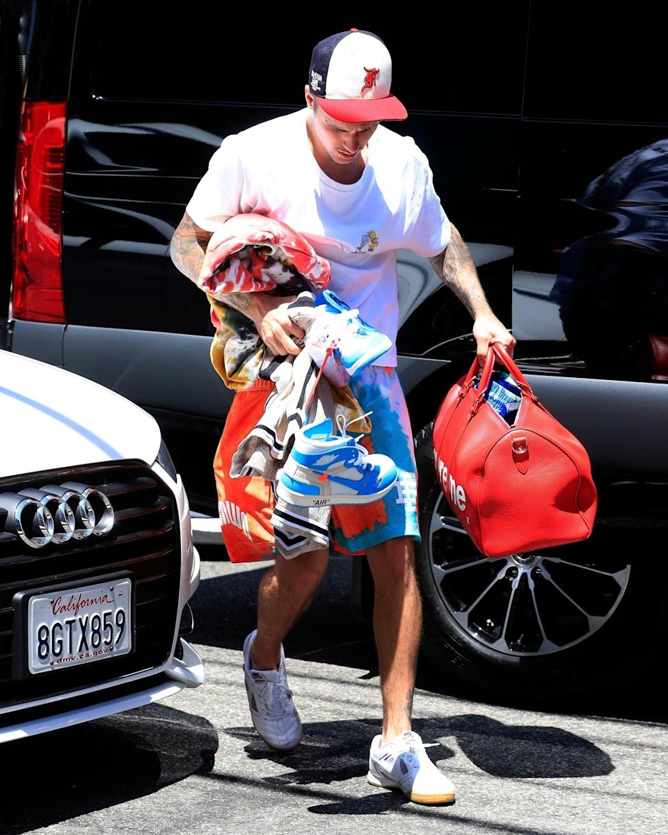 """<h1 class=""""title"""">August 22: Justin Bieber</h1> <div class=""""caption""""> A #BigFitoftheDay so enormous, Justin Bieber cannot physically contain it with two arms. </div> <cite class=""""credit"""">Getty Images</cite>"""