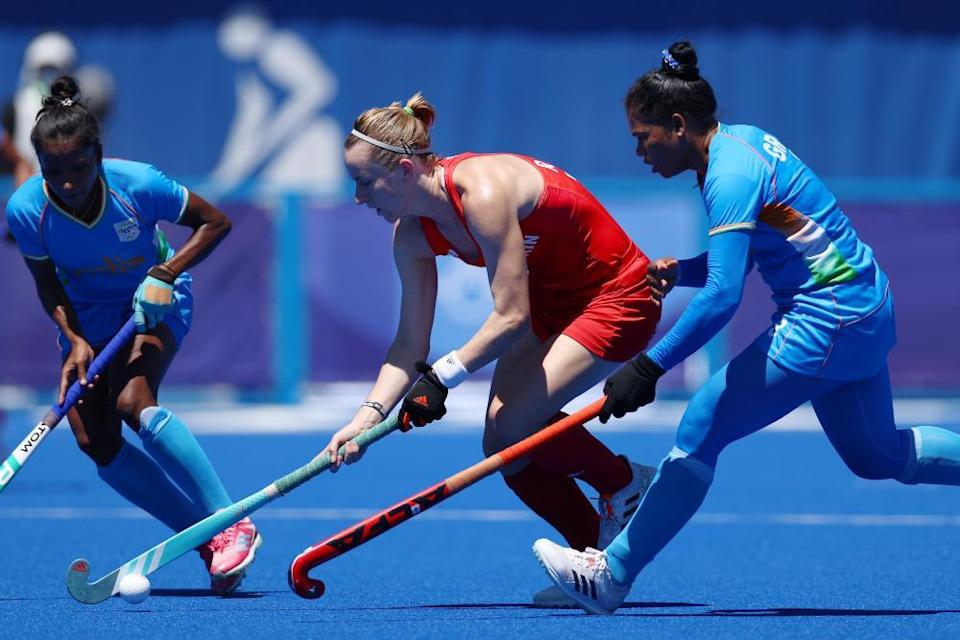 Elena Sian Rayer of Great Britain and Deep Grace Ekka of Team India battle for a loose ball.