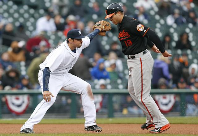Detroit Tigers third baseman Nick Castellanos reaches to tag Baltimore Orioles' Chris Davis, right, out on Orioles' Steve Clevenger ground ball in the fourth inning of a baseball game in Detroit, Friday, April 4, 2014. (AP Photo/Paul Sancya)