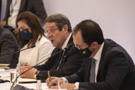 Cyprus' President Nikos Anastasiades, center, speaks during a meeting in Athens, on Wednesday, July 28, 2021. Greece is hosting a one-day trilateral meeting of the three leaders. (AP Photo/Yorgos Karahalis)