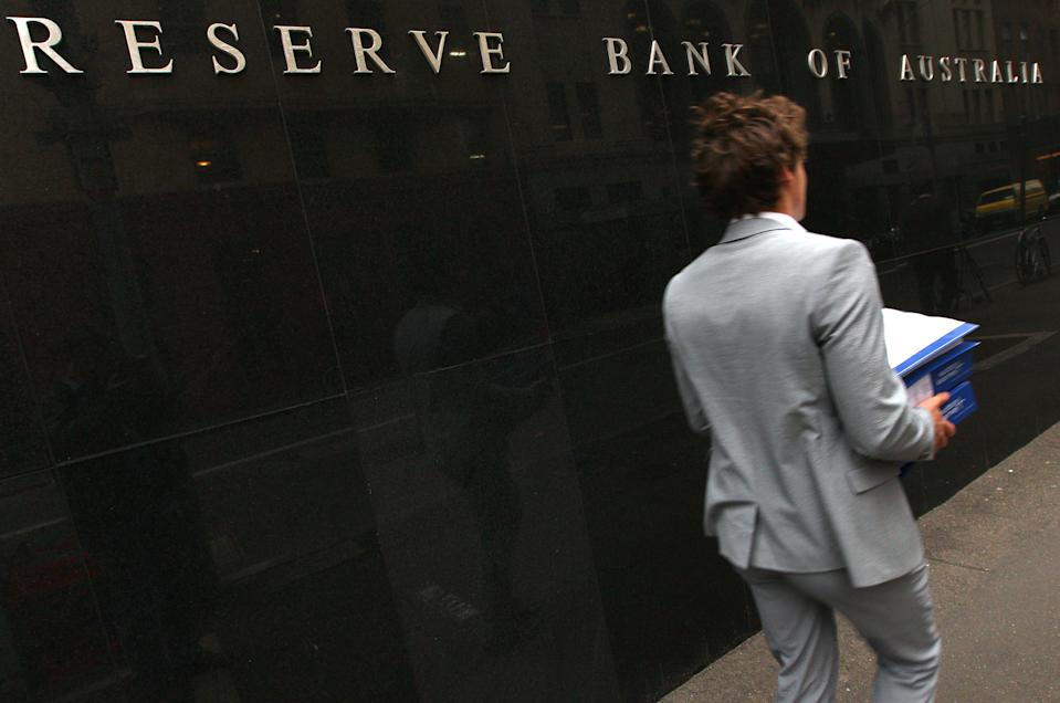A man walks past the Reserve Bank of Australia in Sydney, Tuesday, June 5, 2012. Australia's central bank has cut its benchmark interest rate for a second consecutive month, lowering it a quarter percentage point to 3.5 percent. (AP Photo/Rick Rycroft)