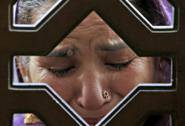 <p>A supporter of Pakistan's slain leader Benazir Bhutto, reacts while visiting her tomb, during a rally to mark the fourth anniversary of her assassination in Gari Khuda Bux near Larkana, Pakistan, Dec. 27, 2011. (AP Photo/Shakil Adil) </p>