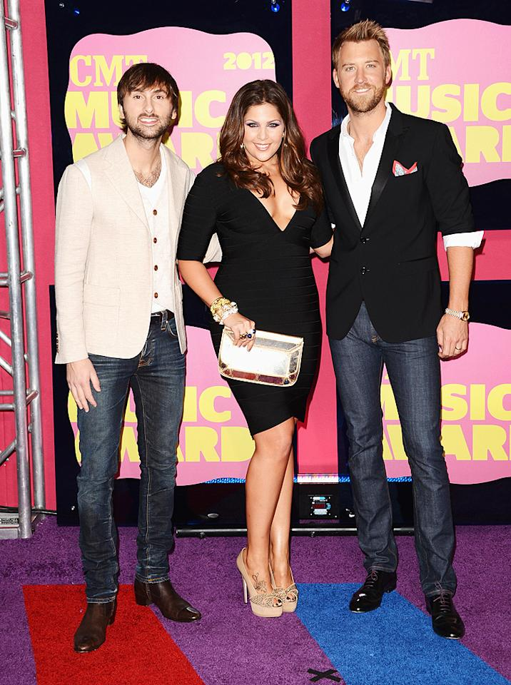 "Lady Antebellum was very monochromatic for their big night. While their lead lady Hillary Scott went for a simple form-fitting LBD with a white clutch, her bandmates Dave Haywood and Charles Kelley (Katherine Heigl's brother-in-law) opted for blue jeans paired with white and black blazers respectively. The trio took home the award for group video of the year (""We Owned the Night)."