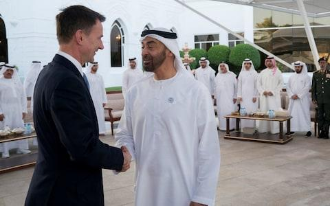 Abu Dhabi's Crown Prince Sheikh Mohammed bin Zayed al-Nahyan shake hands with British Foreign Minister Jeremy Hunt in Abu Dhabi - Credit: Reuters