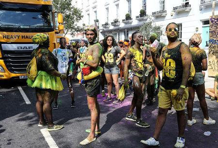 Revellers stand for a minutes silence during the Notting Hill Carnival in London, Britain August 27, 2017. REUTERS/Eddie Keogh