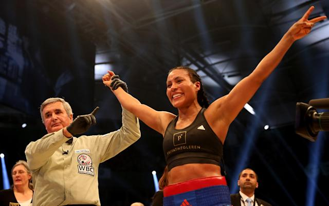 Cecilia Braekhus celebrates after her Welterweight World Championship fight against Chris Namus at Gerry Weber Stadium on February 27, 2016 in Halle, Germany. (Getty Images)