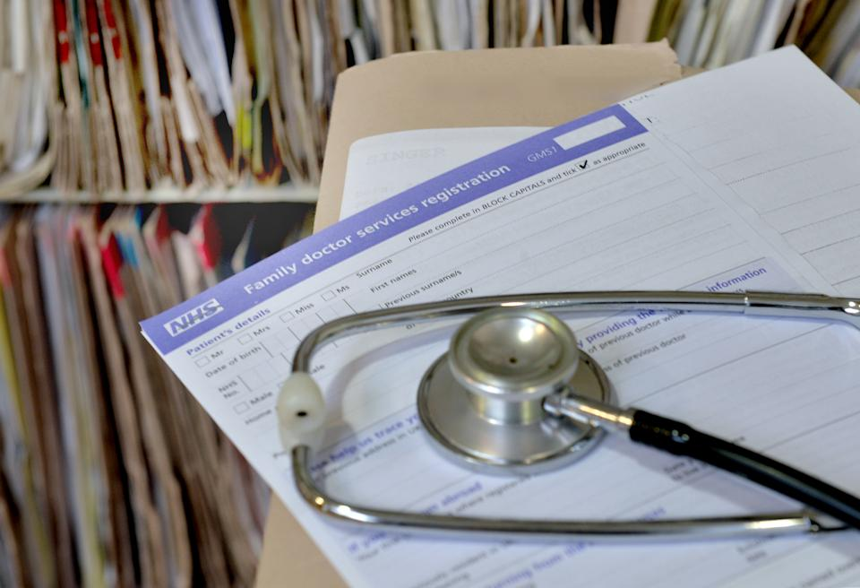 A registration form and a stethoscope at the Temple Fortune Health Centre GP Practice near Golders Green, London.