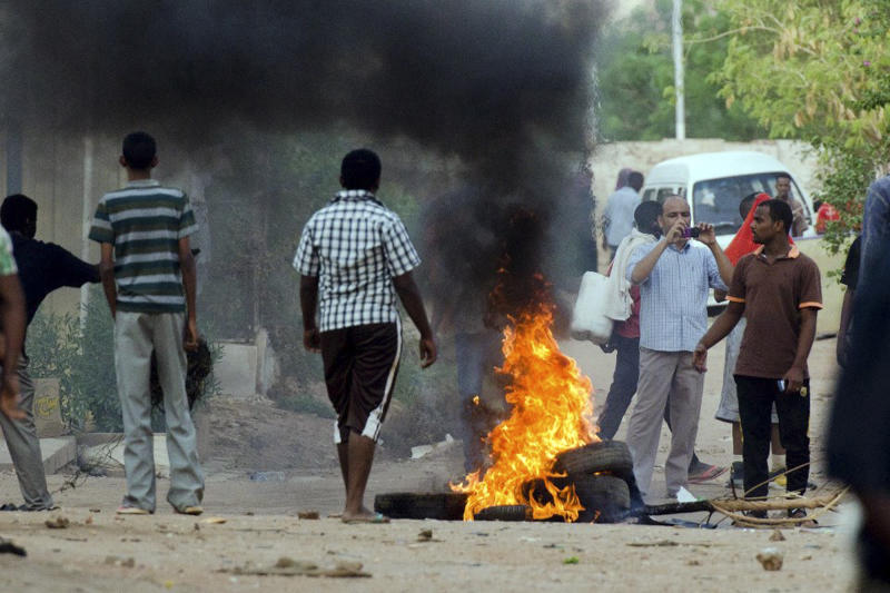 FILE - In this Friday, June 22, 2012 file citizen journalism photo provided by the group Grifina, tires burn during a protest in Khartoum, Sudan. The government unleashed a campaign of fear in retaliation to what they called acts of sabotage and attempts to destabilize Sudan. It was the regime's response to stem any protest movements that are inspired by the regional uprisings. Khartoum is currently in lengthy torturous negotiations with South Sudan to resolve the oil sharing dispute, and demarcate the borders, after the two came close to returning to civil war earlier this year. (AP Photo, File)THE ASSOCIATED PRESS CANNOT INDEPENDENTLY VERIFY THE CONTENT, DATE, LOCATION OR AUTHENTICITY OF THIS MATERIAL.