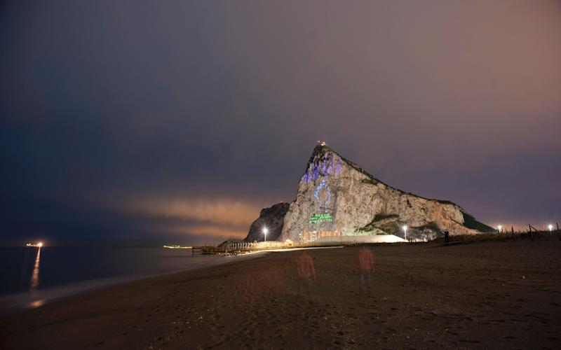 Queen Elizabeth II projected on the Rock of Gibraltar - Credit: JORGE GUERRERO/AFP