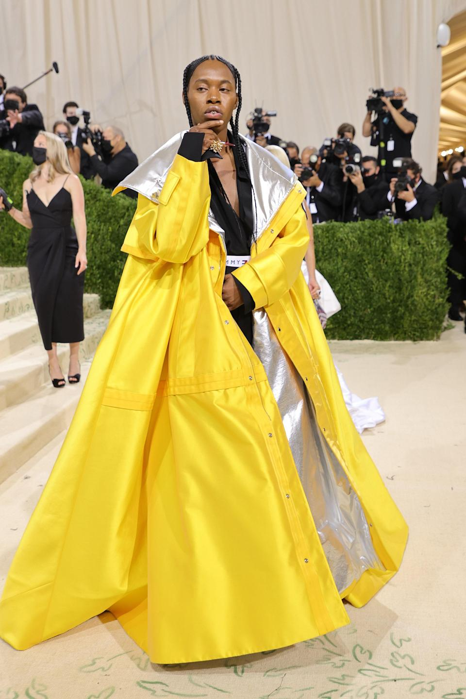 Playwright Jeremy O. Harris's Tommy Hilfiger look may look familiar. His oversized yellow and silver coat is an exaggerated version of the same one worn by icon Aaliyah back in the '90s. American designer with American influence.