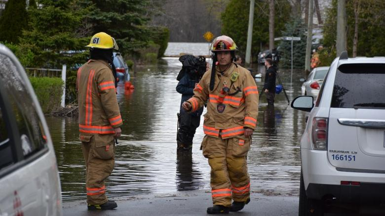 Man and young girl missing in Quebec flooding