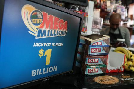 A sign advertising tickets for the $1-billion Mega Millions lottery drawing is seen in Brooklyn, New York
