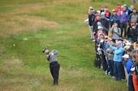 US golfer Webb Simpson hits out from the rough on the second hole during the first round of the British Open golf Championships at Royal Portrush golf club in Northern Ireland on July 18, 2019. (Photo by Glyn KIRK / AFP)