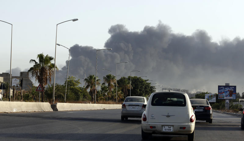 Smoke billows from a petrol depot set ablaze during clashes between rival militias near the Tripoli's international airport, August 13, 2014