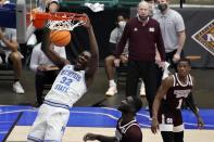 Memphis center Moussa Cisse (32) dunks the ball as Mississippi State forward Abdul Ado, center, and guard Iverson Molinar (1) look on in the first half of an NCAA college basketball championship game in the NIT, Sunday, March 28, 2021, in Frisco, Texas. (AP Photo/Tony Gutierrez)