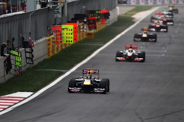 YEONGAM-GUN, SOUTH KOREA - OCTOBER 16: Sebastian Vettel of Germany and Red Bull Racing leads from Lewis Hamilton of Great Britain and McLaren early in the Korean Formula One Grand Prix at the Korea International Circuit on October 16, 2011 in Yeongam-gun, South Korea. (Photo by Mark Thompson/Getty Images)