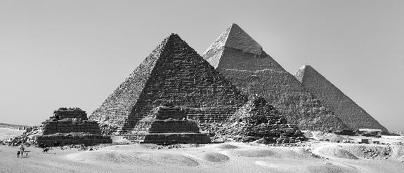 The pyramid of Menkaure, with three queens' pyramids in front. Behind are the pyramids of Khafre and Khufu. The workers' town that archaeologists have been exploring was used to house laborers building Menkaure's pyramid.