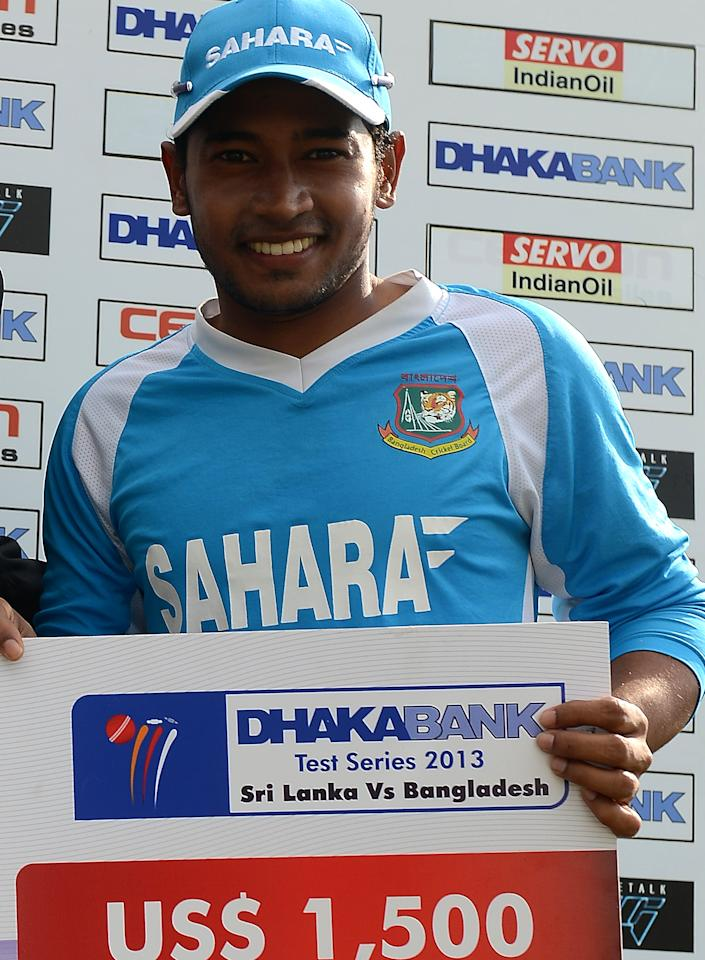 Bangladeshi captain Mushfiqur Rahim poses with The Man Of The Match prize after a presentation ceremony at the end of the opening Test match between Sri Lanka and Bangladesh at the Galle International Cricket Stadium in Galle on March 12, 2013.  The opening Test between Sri Lanka and Bangladesh ended in a tame draw on the fifth and final day at the Galle International Stadium on Tuesday. AFP PHOTO/ LAKRUWAN WANNIARACHCHI        (Photo credit should read LAKRUWAN WANNIARACHCHI/AFP/Getty Images)