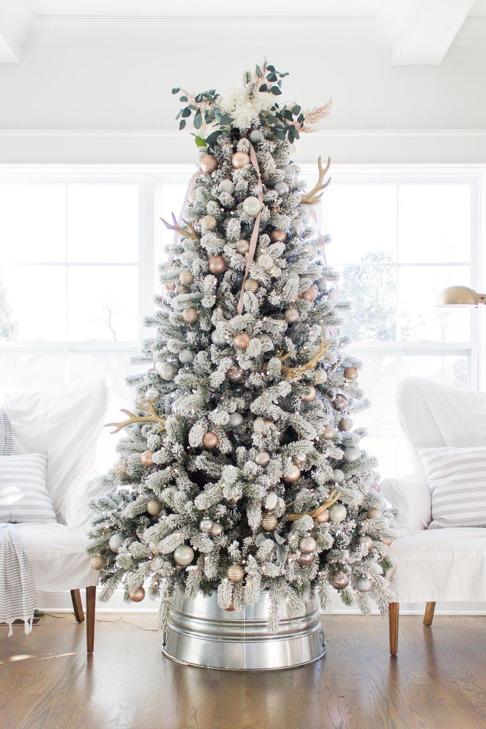 "<p>Why spend oodles when you can create this gorgeous, shiny galvanized collar on your own? It's beautiful in modern or farmhouse-styled rooms. </p><p><strong>Get the tutorial at <a href=""https://aehomestylelife.com/make-designer-inspired-galvanized-christmas-tree-collar-less-30/"" rel=""nofollow noopener"" target=""_blank"" data-ylk=""slk:AE Home Style Life"" class=""link rapid-noclick-resp"">AE Home Style Life</a>.</strong></p><p><a class=""link rapid-noclick-resp"" href=""https://go.redirectingat.com?id=74968X1596630&url=https%3A%2F%2Fwww.homedepot.com%2Fp%2FBehrens-17-Gal-Galvanized-Steel-Round-Tub-3GSX%2F206638138&sref=https%3A%2F%2Fwww.countryliving.com%2Fdiy-crafts%2Fg28746492%2Fdiy-christmas-tree-stands%2F"" rel=""nofollow noopener"" target=""_blank"" data-ylk=""slk:SHOP GALVANIZED TUBS"">SHOP GALVANIZED TUBS</a></p>"