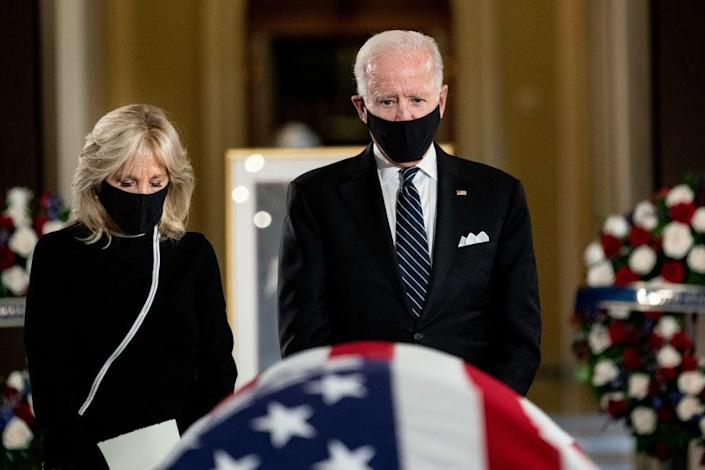 Democratic presidential nominee Joe Biden and his wife, Jill, pay their respects to the late Justice Ruth Bader Ginsburg at the US Capitol. (Getty Images)