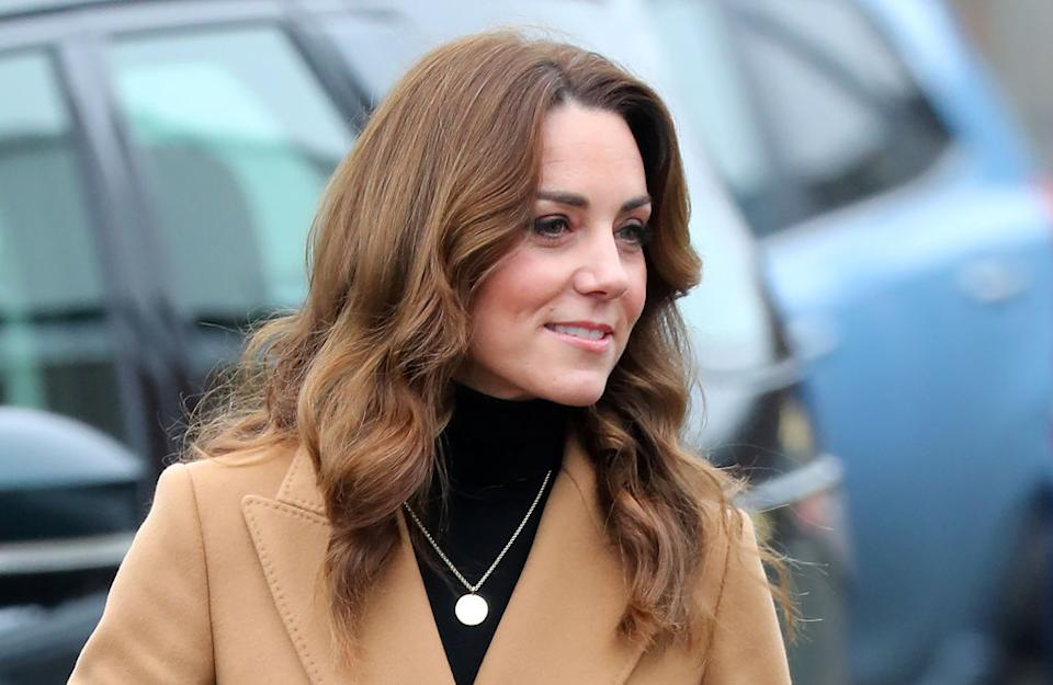 The Duchess of Cambridge looked classically elegant in a chic camel coat [Photo: Getty]