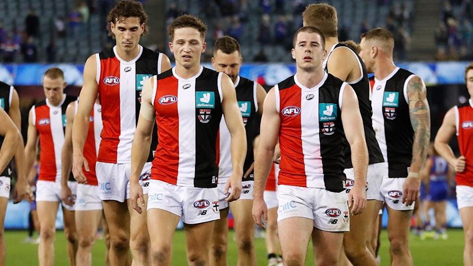 St Kilda players, pictured here leaving the field after their humiliating loss to the Western Bulldogs.