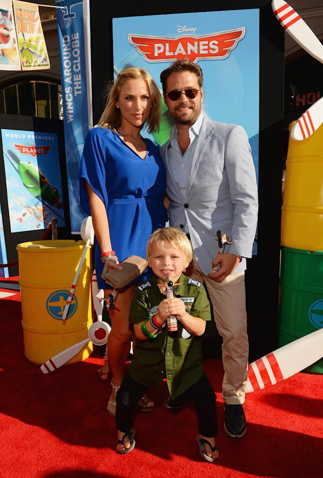 "HOLLYWOOD, CA - AUGUST 05: (L-R) Naomi Lowde Priestley, son, Dashiell Priestley and actor Jason Priestley attend the premiere of Disney's ""Planes"" at the El Capitan Theatre on August 5, 2013 in Hollywood, California.  (Photo by Mark Davis/Getty Images)"