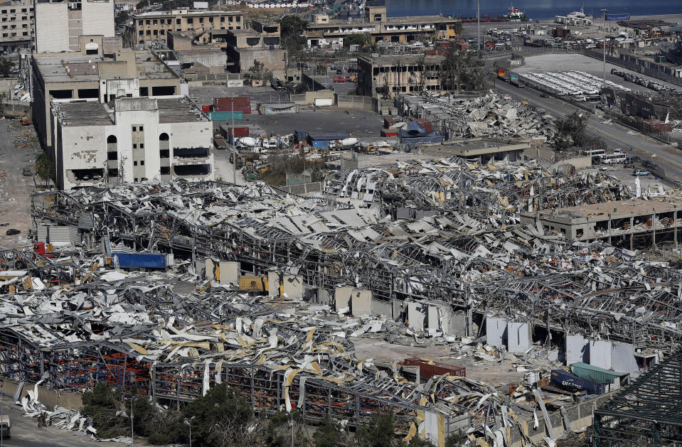 A general view shows the port warehouses destroyed by Tuesday's explosion that hit the seaport of Beirut, Lebanon, Friday, Aug. 7, 2020. Rescue teams were still searching the rubble of Beirut's port for bodies on Friday, nearly three days after a massive explosion sent a wave of destruction through Lebanon's capital, killing over a hundred people and wounding thousands. (AP Photo/Hussein Malla)