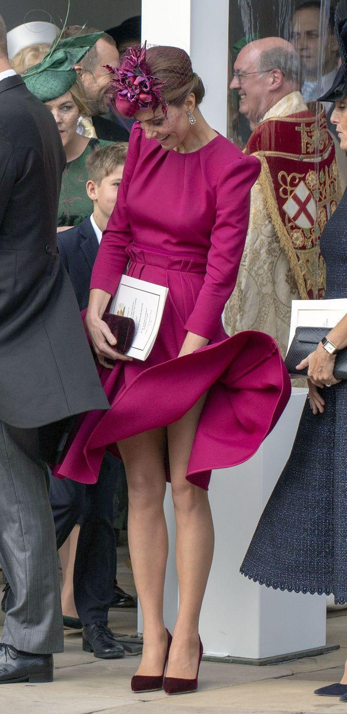 <p>Another go-to fashion hack royals use to stop wardrobe malfunctions is weights added to their skirts and dresses. Seems like the royal family stylist sometimes runs out of time to employ this trick, though, as evidenced here by Kate's flying-skirt moment at Princess Eugenie's wedding in October 2018. Whoopsie! </p>