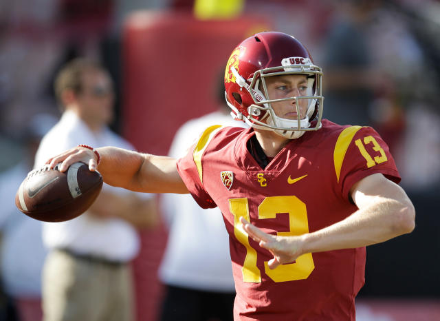FILE - In this Sept. 9, 2017, file photo, Southern California quarterback Jack Sears warms up before the team's NCAA college football game against Stanford in Los Angeles. Matt Fink and Sears completed USCs spring football workouts in close competition for the chance to replace Sam Darnold as starting quarterback later this year. The competition will heat up in the summer when top recruit J.T. Daniels graduates from high school and joins the Trojans quarterback group. (AP Photo/Jae C. Hong, File)