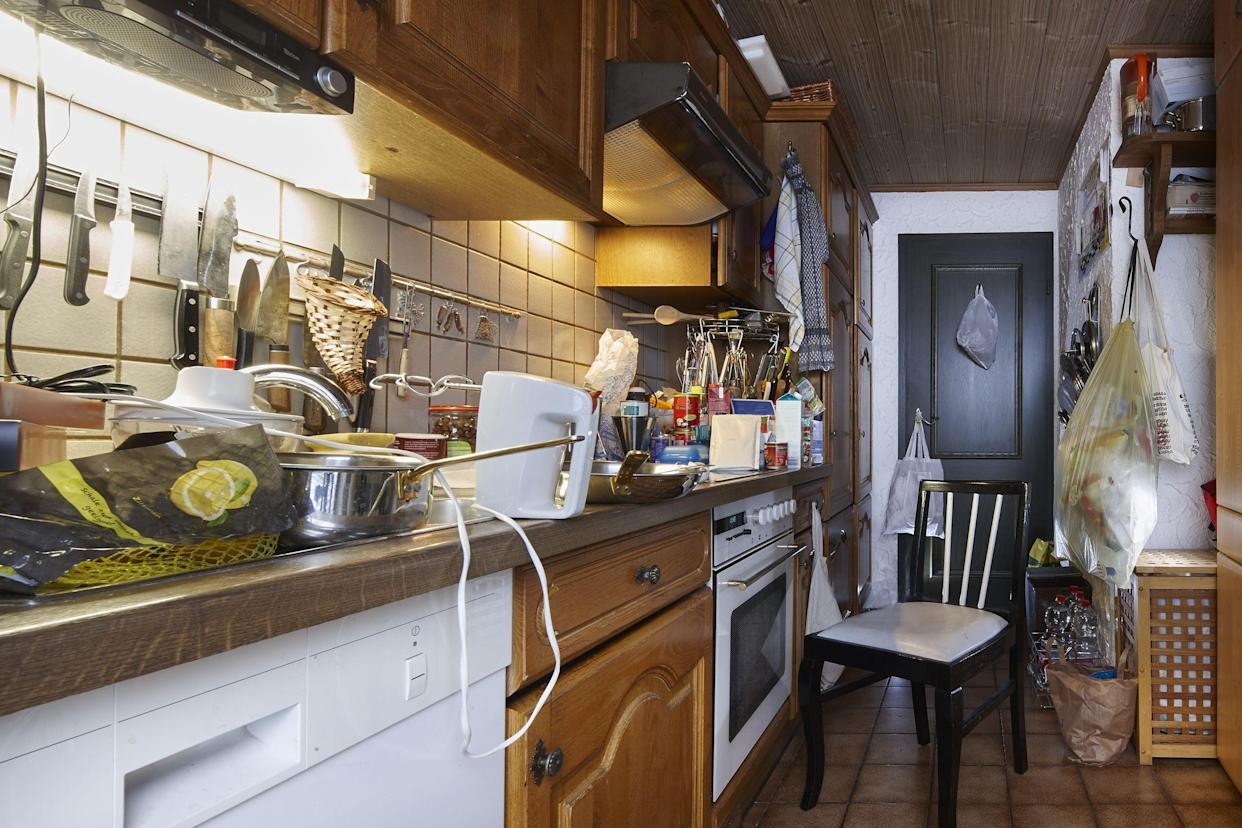 messy and cluttered unclean kitchen