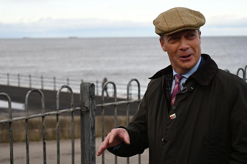 Brexit Party leader Nigel Farage visits the Headland War memorial in Hartlepool, northeast England on November 11, 2019 during a general election campaign visit. - Britain will go to the polls on December 12 to vote in a pre-Christmas general election. (Photo by Paul ELLIS / AFP) (Photo by PAUL ELLIS/AFP via Getty Images)