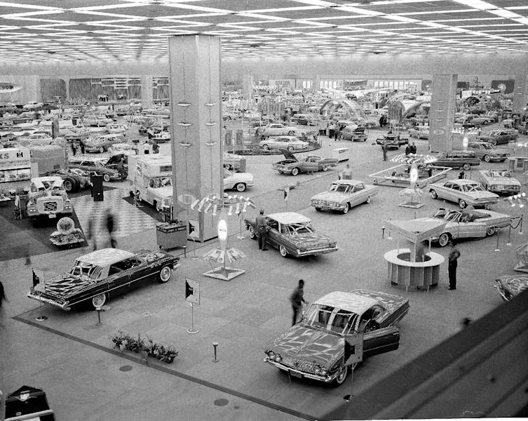 FILE -In this Oct. 14, 1960 file photo, people visit the National Auto Show at Cobo Hall in Detroit. In 2013, more than 795,000 people, including 5,200 journalists from around the world attended the show. (AP Photo/File)