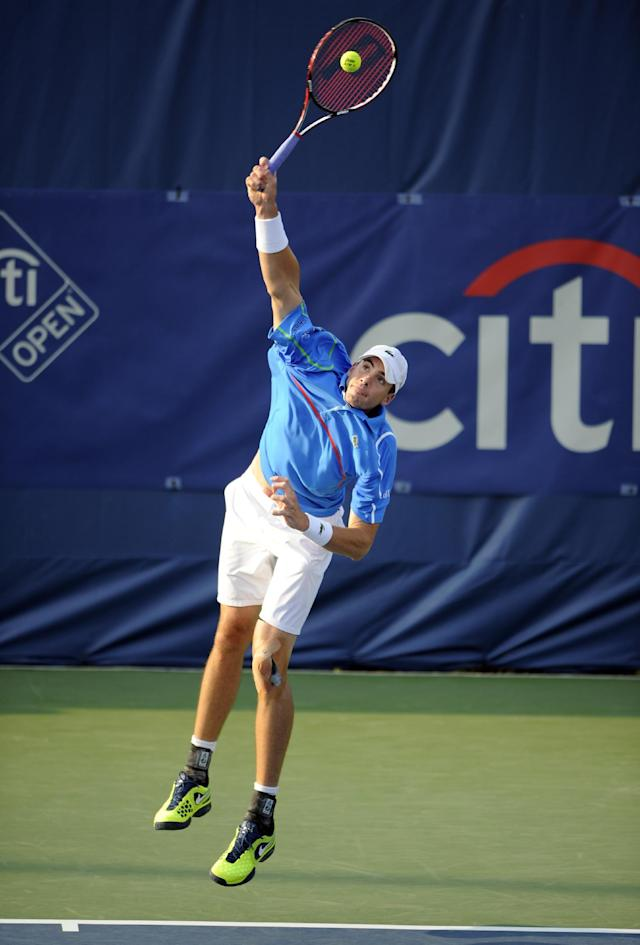 John Isner serves against Steve Johnson during a match at the Citi Open tennis tournament, Wednesday, July 30, 2014, in Washington. (AP Photo/Nick Wass)