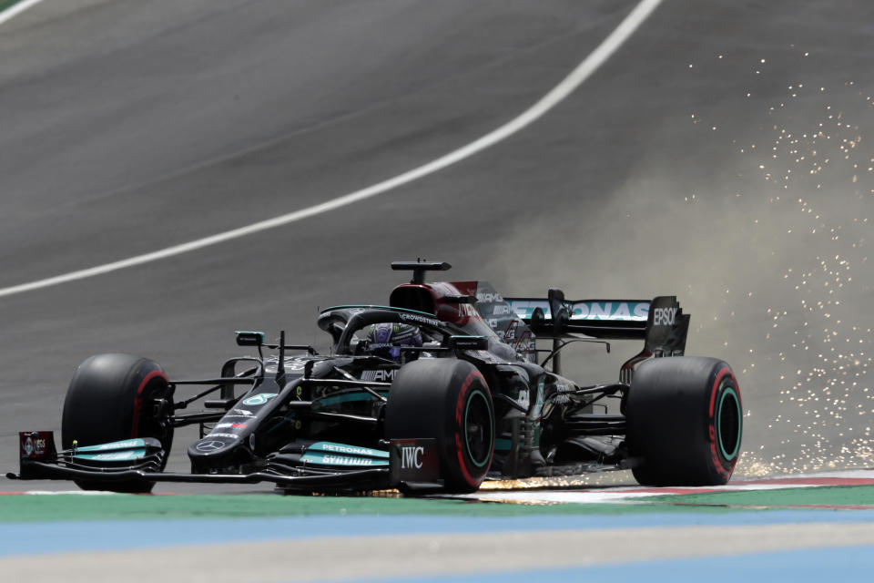 Mercedes driver Lewis Hamilton of Britain leaves a trail of sparks during the third free practice session ahead of the Portugal Formula One Grand Prix at the Algarve International Circuit near Portimao, Portugal, Saturday, May 1, 2021. The Portugal Grand Prix will be held on Sunday. (AP Photo/Manu Fernandez)