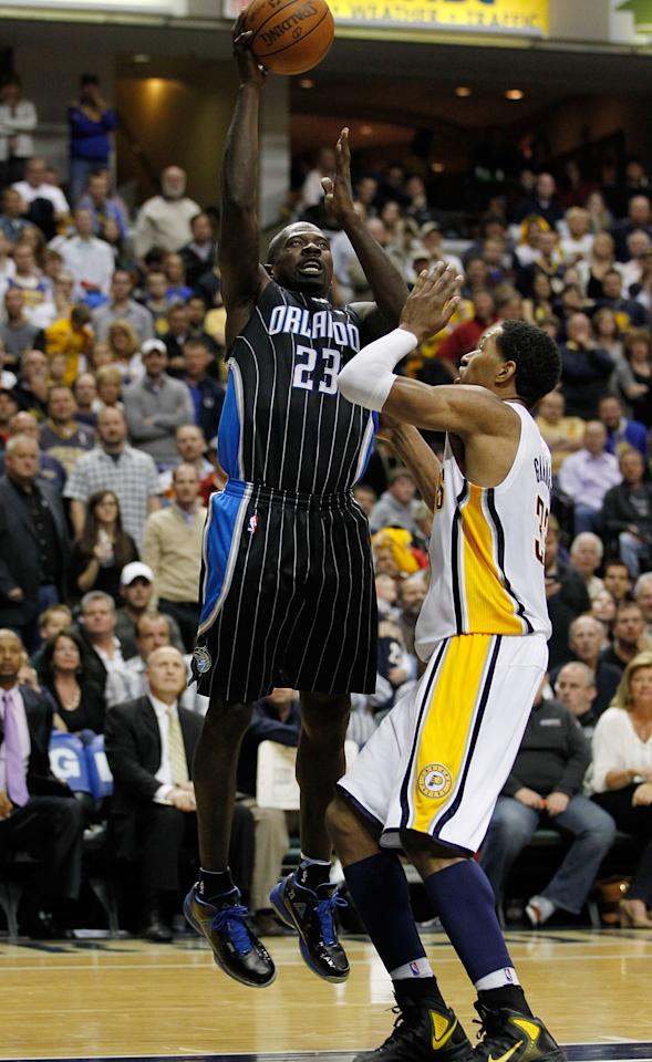 INDIANAPOLIS, IN - APRIL 28: Jason Richardson #23 of the Orlando Magic gets a shot off over Danny Granger #33 of the Indiana Pacers in Game One of the Eastern Conference Quarterfinals during the 2012 NBA Playoffs on April 28, 2012 at Bankers Life Fieldhouse in Indianapolis, Indiana. Orlando won the game 81-77 to take a 1-0 series lead. NOTE TO USER: User expressly acknowledges and agrees that, by downloading and or using this photograph, User is consenting to the terms and conditions of the Getty Images License Agreement. (Photo by Gregory Shamus/Getty Images)