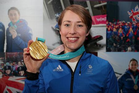 FILE PHOTO: Winter Olympics - Team GB Homecoming - Heathrow Airport, London, Britain - February 26, 2018 Lizzy Yarnold of Britain poses with her gold medal Action Images via Reuters/Peter Cziborra/File Photo