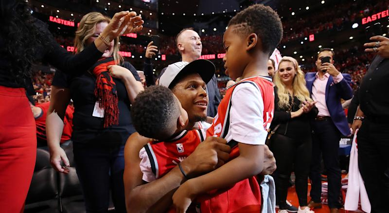 Toronto's Kyle Lowry celebrates with his sons Kameron and Karter after defeating the Milwaukee Bucks 100-94 in Game 6 of the NBA Eastern Conference Finals. (Photo by Gregory Shamus/Getty Images)