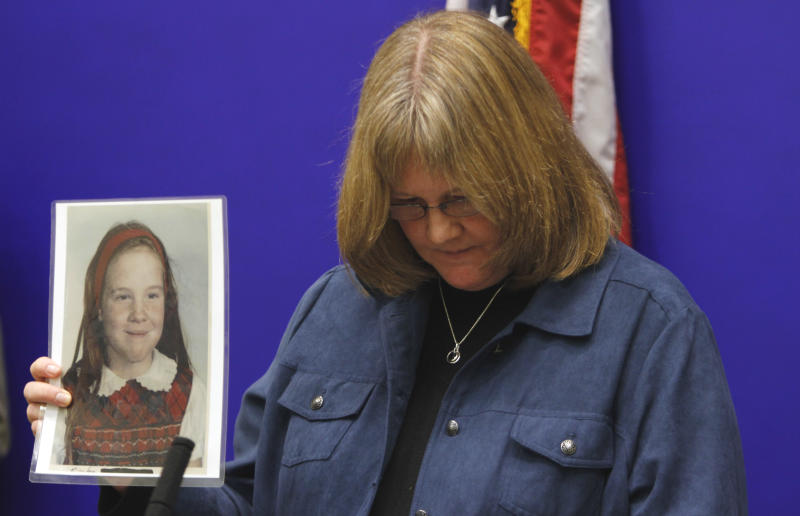 """FILE - In this Thursday, Jan. 27, 2011 file photo, Becky Ianni holds a photo of herself as a child during a news conference on legislation dealing with the statue of limitations on how long victims of sex abuse have to file civil lawsuits at the Capitol in Richmond, Va. While many Americans are riveted by the Penn State sex abuse trial, it has been particularly wrenching - and sometimes heartening - for those who were themselves victims of abuse in their youth. Ianni waited until she was 48 to speak out about abuse she says she endured at the hands of a priest when she was 9 and 10. When she decided to speak out, in 2006, she went before a church review board to make her allegations, and burst into tears as she underwent questioning. She said memories of that encounter resurfaced as she followed the reports of some of the Sandusky witnesses fighting back tears during their testimony. She admitted to a trace of envy that the witnesses have a chance to confront Sandusky. """"My perpetrator committed suicide in 1992,"""" she said. """"I had no chance to confront him.""""(AP Photo/Steve Helber)"""