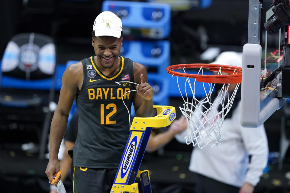 Baylor guard Jared Butler cuts down the net after the championship game against Gonzaga in the men's Final Four NCAA college basketball tournament, Monday, April 5, 2021, at Lucas Oil Stadium in Indianapolis. Baylor won 86-70. (AP Photo/Darron Cummings)