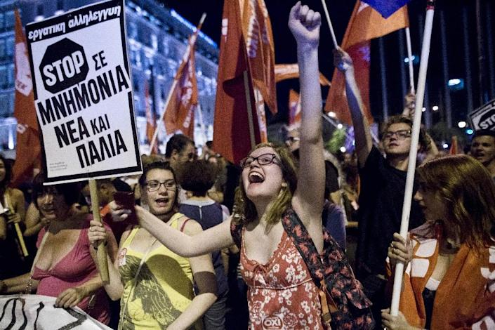 People shout slogans in front of parliament in Athens on July 5, 2015 after the first exit-polls of the Greek referendum (AFP Photo/Angelos Tzortzinis)