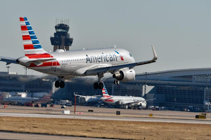 An American Airlines plane taking off.