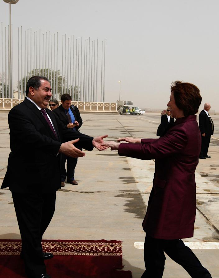 Iraq's Foreign Minister Hoshyar Zebari, left, welcomes the EU foreign policy chief Catherine Ashton upon her arrival at Baghdad International Airport in Iraq, Wednesday, May 23, 2012. Negotiators from the U.S. and five other world powers sat down Wednesday with a team of Iranian diplomats to try to hammer out specific goals in the years-long impasse over Tehran's nuclear program.(AP Photo/Mohammed Ameen, Pool)