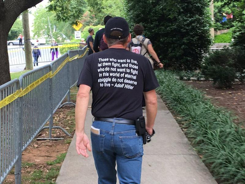 "A man wears Nazi regalia before the ""Unite the Right"" rally."