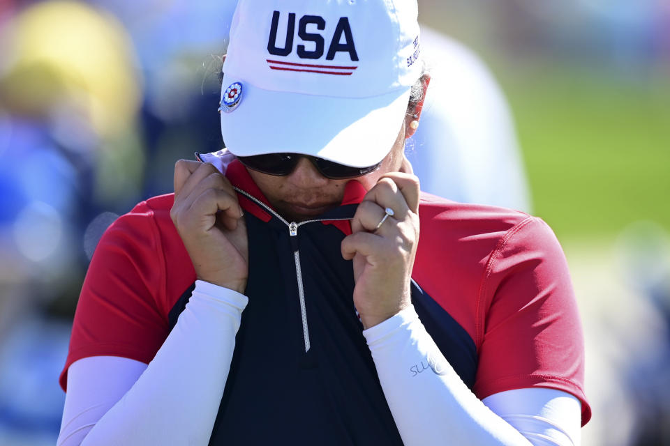 United States' Mina Harigae wipes her face after being defeated by Europe's Celine Boutier on the 14th hole during the singles matches at the Solheim Cup golf tournament, Monday, Sept. 6, 2021, in Toledo, Ohio. (AP Photo/David Dermer)