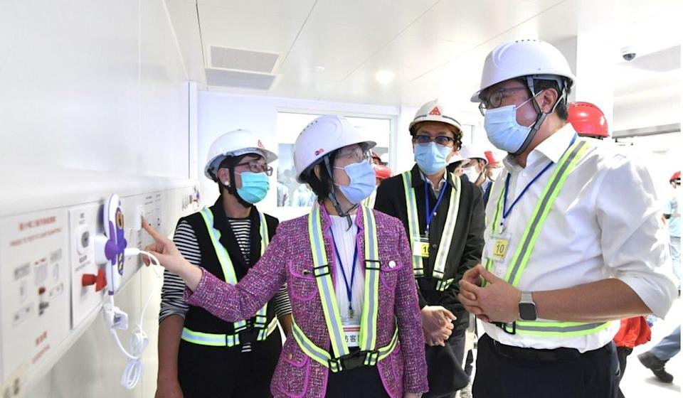 (From left) Architectural Services deputy director Sylvia Lam Yu Ka-wai, health secretary Sophia Chan Siu-chee and Michael Wong visit the site. Photo: SCMP