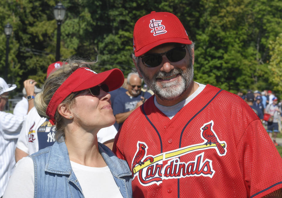 Gwen English, left, and her husband Ron English attend the National Baseball Hall of Fame induction ceremony at the Clark Sports Center, Wednesday, Sept. 8, 2021, in Cooperstown, N.Y. (AP Photo/Hans Pennink)