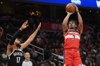 Washington Wizards guard Bradley Beal (3) shoots next to Brooklyn Nets guard Garrett Temple (17) during the first half of an NBA basketball game, Saturday, Feb. 1, 2020, in Washington. (AP Photo/Nick Wass)